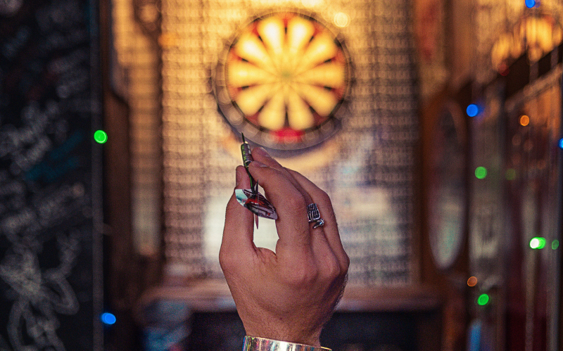photo of person throwing a dart to represent how to make some goals