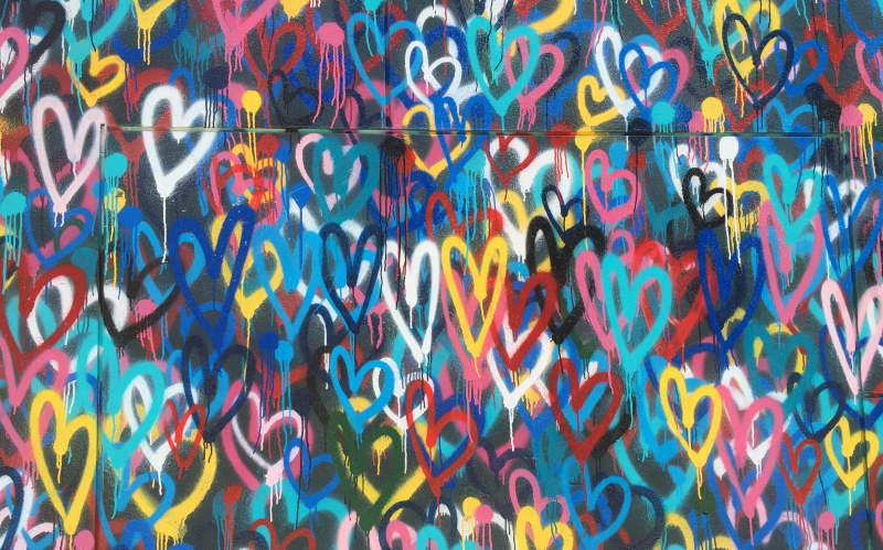 Photo of graffitti hearts to represent how to create raving fans and clients who love you