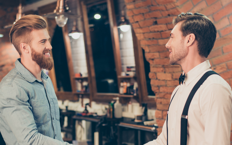 Photo of two men making eye contact in a barbershop